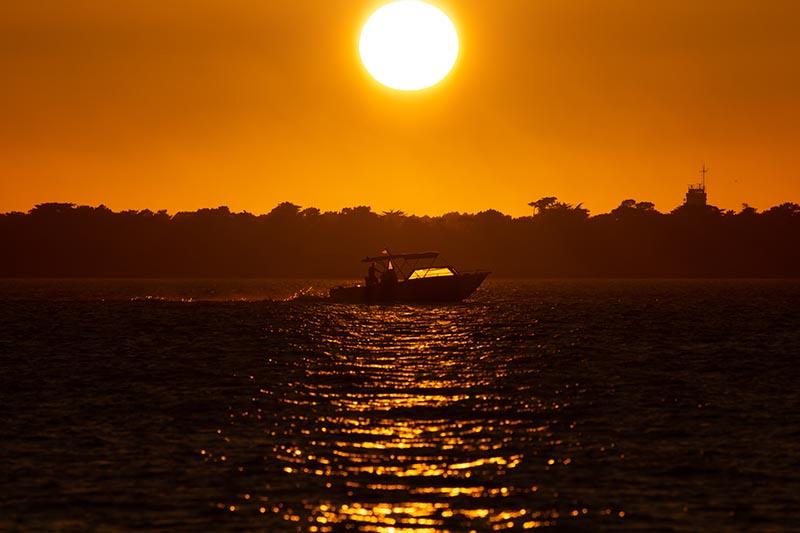 Photographie paysage sunset boat un coucher de soleil