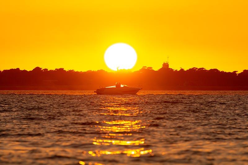 Photographie Paysage Homecoming d'un bateau rentrant au port